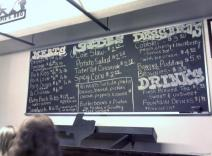 Opie's BBQ Menu chalkboard photo includes pricing.jpg
