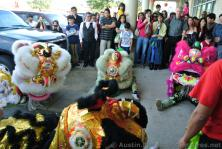 Lion Dance performers take a break sitting on the ground.jpg
